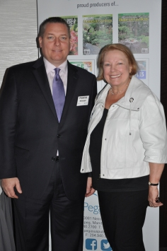 VP Pascal Belanger of the Winnipeg Richardson International Airport with Dorothy Dobbie of Pegasus Publications