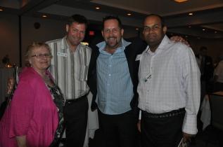 Gail McDonald and Jacques Bourgeois of Oak Hammock Marsh with Pegasus's Ian Leatt and Daljit Singh