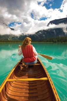 Take a break and canoe through peaceful waters. (Photo by Dave Heath / Tourism BC.)