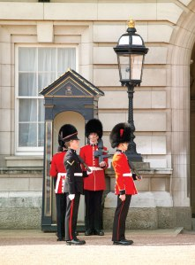 Coldstream Guards at a sentry box during the Changing of the Guard ceremony outside Buckingham Palace. Photo by London on View.