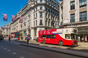 Double decker bus tour makes its way past the shops. (Photo credit London on View)