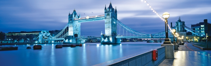 View of Tower Bridge from the south side of the River Thames at night.