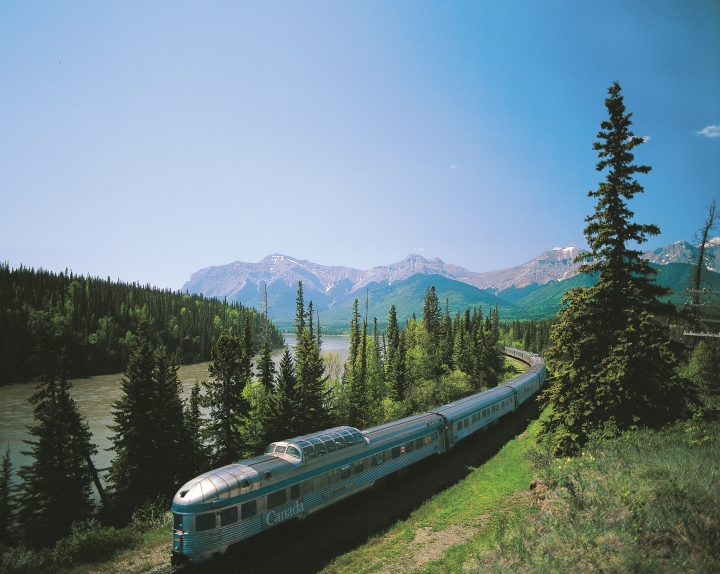 The train winds its way through the mountains.