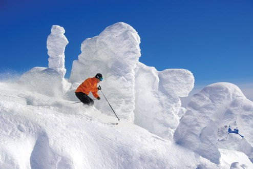 Downhill skiing past 'snow ghosts' at Big White Ski Resort.
