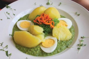 Frankfurt's grüne soße (green sauce), is a mix of yogurt and seven herbs, typically served with hard-boiled eggs and potatoes.