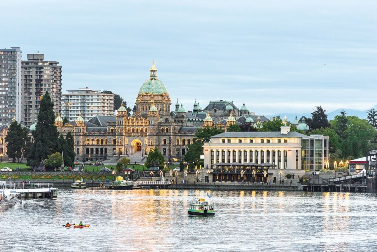 As dusk descends upon the Victoria harbourfront, the parliament buildings are lit up by thousands of lights.