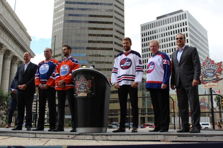 """The unveiling of the """"classic"""" jerseys at Portage and Main. Left to right: Kevin Lowe, Dave Semenko, Cam Talbot, Blake Wheeler, Thomas Steen and Dale Hawerchuk."""