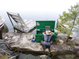 Setting up a stationary hydroacoustics system in Lake 626 to observe the movements of invertebrates and lake fish.