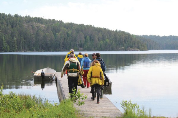 Visitors to Experimental Lakes Area prepare to board a boat.