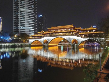 The elegant Anshung Bridge and all its pagodas are lit up at night.